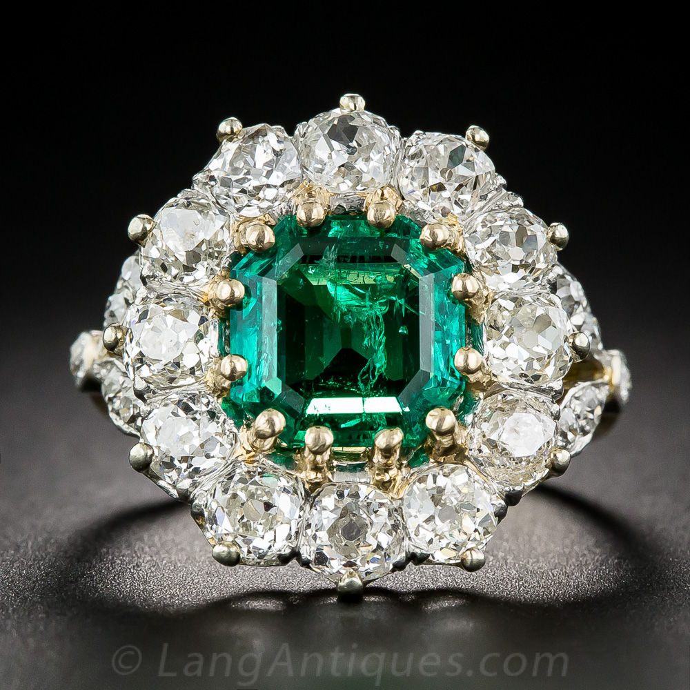 Antique Emerald And Diamond Halo Ring