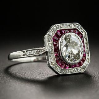 Art Deco .86 Carat Antique Oval Diamond and Ruby Platinum Ring