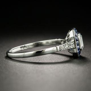 Art Deco Style .55 Carat Emerald-Cut Diamond and Sapphire Halo Ring