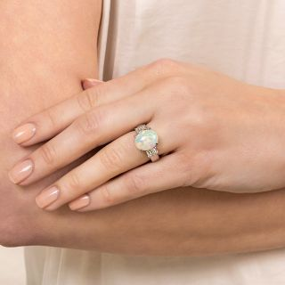 Classic 3.36 Carat Opal and Diamond Ring