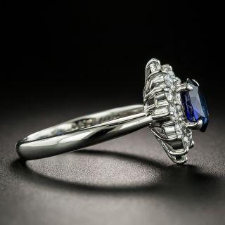 Estate 1.10 Carat Sapphire and Diamond Halo Ring