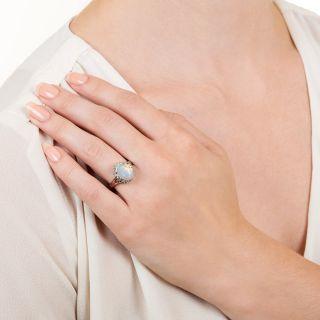 Estate 1.25 Carat Opal and Diamond Halo Ring