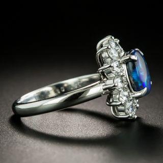 Estate 1.67 Carat Black Opal and Diamond Halo Ring