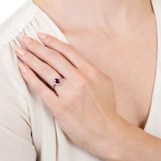 Estate .68 Carat Oval Ruby and Diamond Halo Ring
