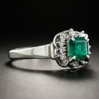 Scrolled Platinum Emerald and Diamond Ring