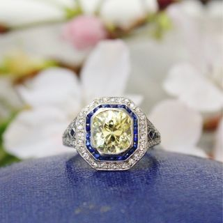 Art Deco 2.18 Carat Fancy Yellow Diamond Ring with Calibre Sapphires