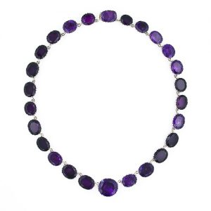 Georgian Amethyst Riviere with Silver Collets and Gold Backings.