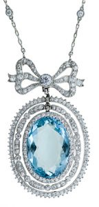 Edwardian Pendant Featuring an Oval Faceted Aquamarine.