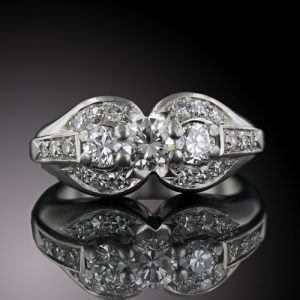 Late Art Deco Three-Stone Diamond Ring.