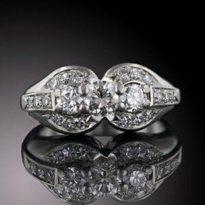 Late Art Deco Three-Stone Diamond Ring.