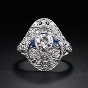 Art Deco Diamond Dinner Ring with Sapphire Accents.