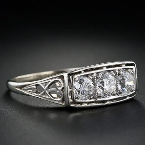 Early Art Deco Three-Stone Diamond Ring.