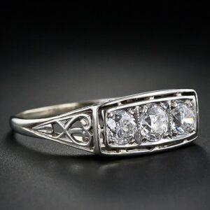 Early Art Deco Three-Stone Diamond Ring.
