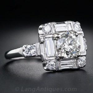 Art Deco Diamond Engagement Ring with a Central European-Cut Diamond Framed by Straight Baguette and Full-Cut Diamonds.