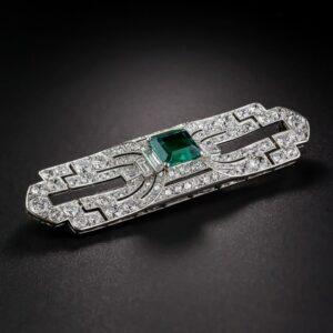 Art Deco Gota De Aceita Emerald Brooch.