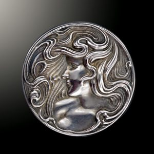 Art Nouveau Silver Feminine Profile with Flowing Hair in the Medallist Style.