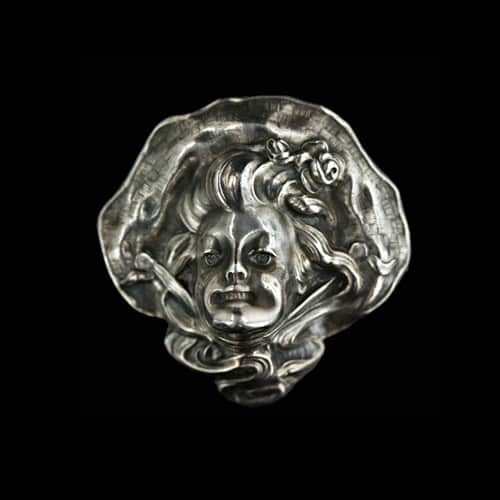 Art Nouveau Silver Laughing Girl Brooch.jpg