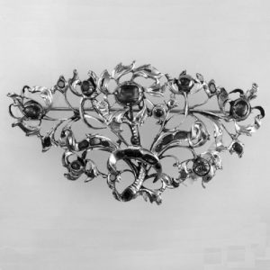 Brooch in the Form of Flowers and Leaves. Silver with a Closed-Back and Set with Rubies and Diamonds. 1726-1775 © The Trustees of the British Museum.