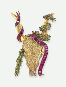 Boivin Yellow Diamond, Ruby, Demantoid Garnet Longhorn Brooch c.1940. Photo Courtesy of Christie's.