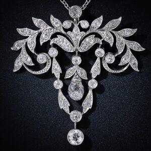 Edwardian Garland Motif Pendant Suspending a Briolette Cut Diamond.
