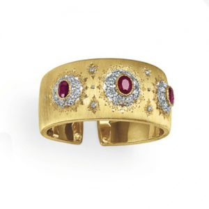 M. Buccellatti Ruby, Diamond and 18K Yellow Gold Hinged Cuff Bracelet. Photo Courtesy of Christie's.