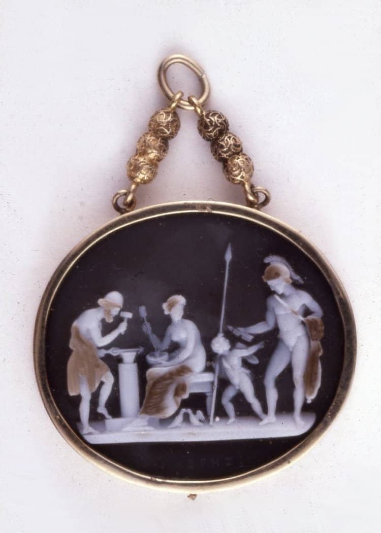 Vulcan's Forge Vulcan, his wife Venus, her lover Mars and Cupid with two Doves. c.early 19th Century, Sardonyx. © Trustees of the British Museum.
