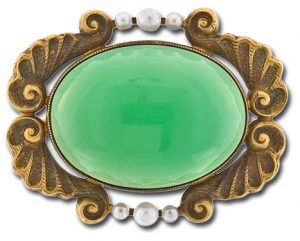 Early 20th Century Pin Centered with a Translucent Oval Cabochon Chrysoprase Chalcedony. Image Courtesy of Lang Antiques