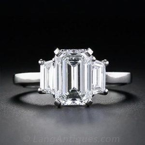 Contemporary Emerald & Trapezoid-Cut Diamond Engagement Ring.