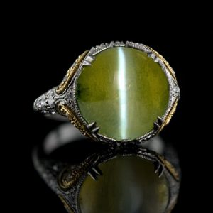 A 9.39 carat Cat's Eye Chrysoberyl is the Star of this Vintage Style Ring.