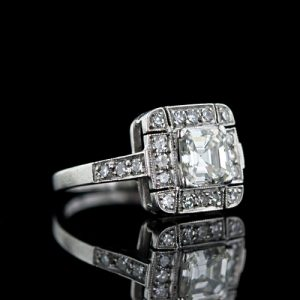 Art Deco Asscher Cut Diamond Ring with Melée Surround.
