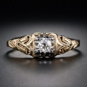 Two-Tone Gold Diamond Ring from the 1920s-30s with Millegrained Openwork Design.