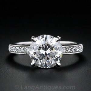 Transitional-Cut Diamond and Platinum Engagement Ring with a Split-Level Gallery and Diamond Shoulders.