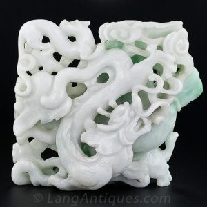 Double-Sided Jadeite Carving Depicting a Spectacular Ferocious Fire-Breathing Dragon.