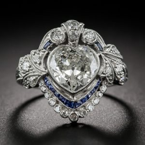 Edwardian Heart-Shaped Diamond and Sapphire Ring Surmounted by a Diamond Coronal Motif.