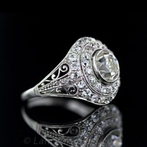 Edwardian Diamond and Platinum Domed Engagement Ring with Milgraining and Scrollwork.