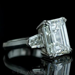 Classic Emerald Cut Diamond Engagement Ring Flanked by a Pair of Shield-Shaped, Step-Cut Diamonds.