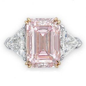 Fancy Intense Pink Diamond Ring Flanked by Diamond Triangles.