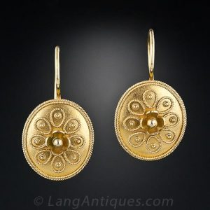 Castellani Victorian Etruscan Revival Disk Form Earrings with Granulation and Wirework Decoration.