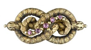 Georgian Lover's Knot with Closed Back Set Garnets, c. 1800.