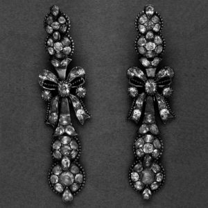 Pair of Earrings. Ribbon-Bows with Long Pendants. Silver and Gold with Closed-Backs and Set with Yellow Chrysoberyls, the Settings Bordered with Gold Beads. 1726-1775 © Trustees of the British Museum.