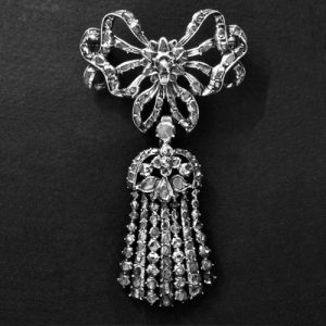 Brooch in the Form of a Ribbon-Bow Surmounting an Epaulette. Silver with a Closed-Back and Set with Diamonds. Late 18th Century © Trustees of the British Museum.