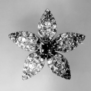 Hair-Pin Ornament in the Form of an Open Flower Set in Closed-Back Silver with Calibré -Cut Emerald-Green and Colourless Pastes. 1790 (circa) © Trustees of the British Museum.