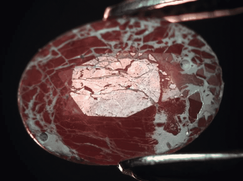 Glass filled ruby after acid attack.png