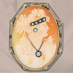 Shell Cameo Habille with Earring, Necklace and Diadem, Set with Diamonds. Circa 1920's.
