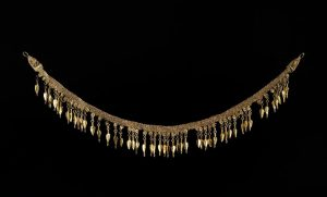 Helenistic Strap Necklace Suspending a Fringe of Seed Shaped Pendants. c.300BC.