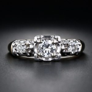 A .30 Carat Transitional Round Brilliant-Cut Diamond Sparkles in this Illusion Style Engagement Ring from the Mid-Century.