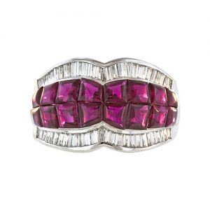 Invisibly Set Rubies Enhance this Feminine Band.