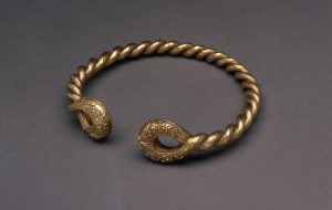 Gold Alloy Torc with Loop Terminals and Twist Design c.75 BC.