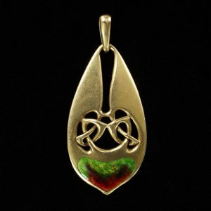 Archibald Knox Unusual Gold Pendant with Enamel Accents, c.1900.