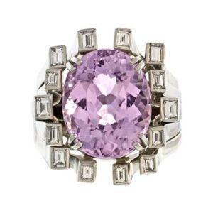 Oval Kunzite in a Diamond Surround.